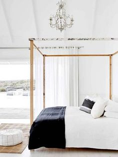 How A Canopy Bed Can Upgrade Your Bedroom Decor: seaside sophisticated