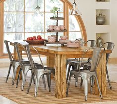 Steel Dining Room Chairs.  I think I really like this look. But with 4 of them and two different chairs on the ends.