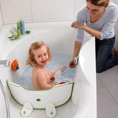 Flexible divider that can turn a regular bathtub into a baby bathtub. Easier to store than a separate tub, saves water and energy for heating water, and safer than just using the whole regular tub! Love this idea!!!