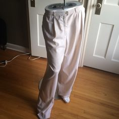 """New Escada Off-white Size 46 US 16 Wool Pants. New Escada Off-white Size 46 US 16 Wool Pants. Purchased new three years ago at Neimans and never wore them. Extra button on label. 96% Wool and 4% Elastine, with two button and zipper closures. Not going back to corporate America after battling terminal cancer. Measurements: Waist 30"""", Two Side Pockets 7""""x6.5"""", Hips 48"""", Inseam 32"""", Length from Waist to Bottom Hem 45"""". No trades. No PayPal. Escada Pants"""