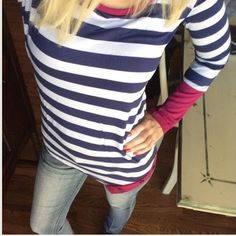 """MAKE AN OFFER I love this fun top with its irregular hem and matching berry color to the sleeves. Navy and white stripes. Length 26.25 sleeve length 23"""".  M - 1 NO PAYPAL NO TRADES. Due to Poshmark's commission, price is FIRM unless bundled. All sales final. Tops Tunics"""
