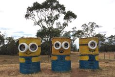 Three minions made from round bales