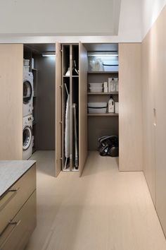 Minimalist Kitchen Design And this long island seamlessly complements that vision. Its length accomm Laundry Room Design, Laundry In Bathroom, Kitchen Design, Laundry Rooms, Laundry Closet, Tiny Closet, Kitchen Interior, Utility Closet, Laundry Area