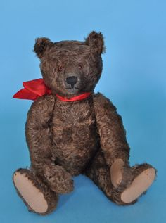 Steiff bear with red bow