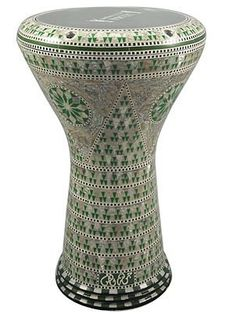 """17"""" Mother of Pearl Doumbek Drum Gawharet El Fan Darbuka by Gawharet El Fan. $249.00. This is a beautiful new 17"""" darbuka. Comes with a clear synthetic head and a premium case. This drum is a top quality drum with shiny shells Egyptian decorations. The Beautiful and intricate inlay of real mother of pearl and the beautiful shiny patterns, make this drum a real work of art.  Covered with real mother of pearl that reflects the spectral colors with shiny shells patterns.  This drum ..."""