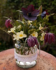 Lace decorated jam jar with primroses, hellebores and snake's head fritillary from www.naomistrachan.co.uk