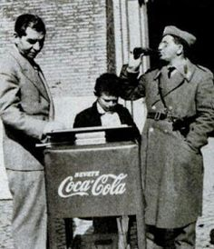 Home sick lucky Luciano buys a Coke in italy.