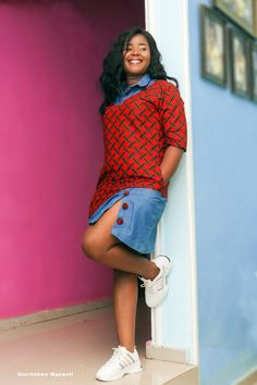 A street savvy shift dress made of a a combination of ankara wax and faux denim. African Fashion Ankara, Latest African Fashion Dresses, African Print Fashion, Africa Fashion, African Attire, African Wear, Jeans Gown, Short African Dresses, Pretty Outfits