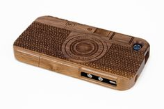 Wood Camera iPhone Case - A laser engraved wood case that looks just like a vintage camera. ($42.00, http://photojojo.com/store)