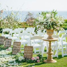 I love the signs, but I also like this idea for the entrance to an outdoor wedding.  They can be moved on to the reception