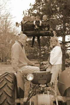 Papa and Cindy with the grand kids .....fun times with the tractor!