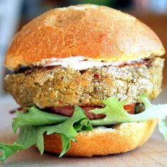 Chickpea Sweet Potato Quinoa Burgers on a bun with lettuce and tomato