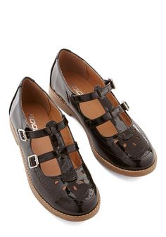 Bit of Brilliance Flat - Low, Faux Leather, Black, Solid, Buckles, Cutout, Casual, Scholastic/Collegiate, Good, Vintage Inspired, 90s.  It sure is vintage - I had shoes like this when I started 1st grade!!!