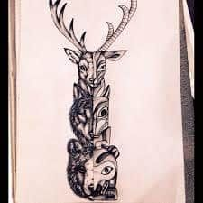 What does totem tattoo mean? We have totem tattoo ideas, designs, symbolism and we explain the meaning behind the tattoo. Native Tattoos, Wolf Tattoos, New Tattoos, Totem Pole Tattoo, Lobo Tribal, Petit Tattoo, Wicked Tattoos, Tattoo Project, Elephant Tattoos