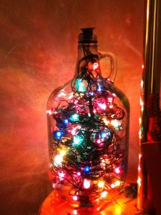 Christmas lights in a wine jug