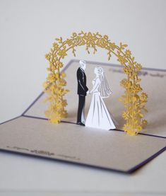 Tell your favorite newlyweds how happy you are for them with this wedding day pop up card