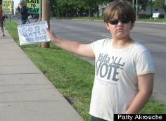 "A 9 year old boy quietly counter-protests the westboro babtist church... ""God Hates No One"""