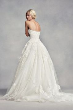 This classic, strapless ball gown features exaggerated botanical lace applique on tulle over patterned net, embellished with organically placed pearls. This artistic and romantic gown would be gorgeous for a wedding in any atmosphere.  White by Vera Wang, eclusively at David's Bridal.  Also available in