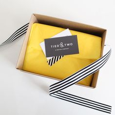 Branding, package design, yellow, black and white, Kraft box, tissue paper, striped logo