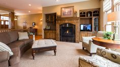 Cozy living room with a fireplace  in this gorgeous Maple Grove home. Listing by Daniel & Julie Desrochers of Coldwell Banker Burnet.