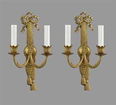 "Offered here is a unique pair of cast brass Regency styled wall sconces, made around the 1950's in Italy.  These pieces have been cleaned, wired and restored by our restoration staff.  These sconces do not have mounting hardware and will need custom mounting depending on the situation. Each sconce measures 13"" tall by 7"" wide by 5"" deep.  Each sconce has two sockets, each accepting one 60 watt candelabra based bulb."