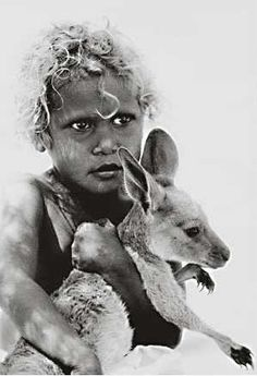 Aboriginal girl with Kangaroo, Australia.