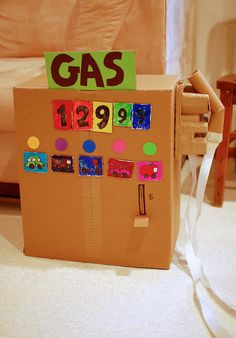 Jackson recently asked me if I would make him a gas station out of our moving boxes. I knew I had seen this before! Man I love her website.