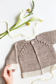 A knit top down cardigan baby sweater called Norwegian Fir by Oge Knitwear Designs! This lovely and fast knit makes the perfect baby gift or layette. Baby Knitting Patterns, Baby Sweater Patterns, Knit Baby Sweaters, Knitted Baby Clothes, Baby Patterns, Cardigan Pattern, Knitted Bags, Baby Pullover, Baby Cardigan