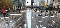 British artist Joe Hill drew the world's largest and longest 3D anamorphic street painting in the Canary Wharf district of London. From Colours of Life, https://www.facebook.com/COL99