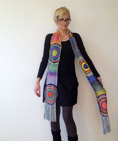 Its long 230cm (90.5 in) without fringes, or 260cm (102.4in) with them. Its crocheted with silky yarn.