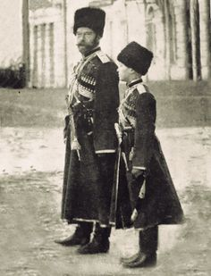 Tsar Nicholas II of Russia and his son, Tsarevich Alexei, in Cossack military uniforms. Photograph taken during the first World War.