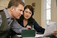 Couple looking at their finances. - Katharine Andriotis/Getty Images