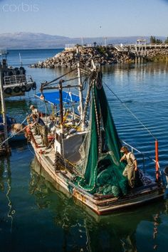 """Fishing Boat on Sea of Galilee - """"Come follow me,""""  Jesus said, """"and I will make you fishers of men."""" ~ Matthew 4:19"""