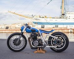 This sweet little bobber was built by Mikhail Matveev (@dyadkamolodec) and his friends, at the Saint Petersburg-based workshop Kon'-Ogon' (loosely translated as 'Fire Horse'). Amazingly, it's based on a dirt bike: a 86-model Honda XR600R.  The engine was pieced together from the best bits of two donors. The front end is from a Ural, the swingarm is completely custom and the rear wheel is originally from a car (an Opel, to be precise).