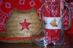 cowboy western theme petting zoo party favors:  cowboy boot mug (for homemade rootbeer) filled with red bandana, barnyard stickers, and a western star lollipop, topped off with a straw cowboy hat