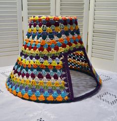 Crochet Cat Teepee Cave Pet Bed Upcycled Lampshade Frame Mulitcolor Boho Handmade  A crocheted cat teepee cave from an upcycled lampshade frame! I removed the fabric from the lampshade and used only the metal frame. I covered the outside with multi-colored acrylic yarn using the granny square stitch for a really unique look! The bottom is open allowing the teepee to sit anywhere you kitty prefers-on a bed, chair, floor...portable to move wherever need be.  Unique home for your artsy kitty…