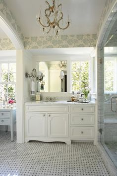 love the layout of this vanity...window and mirror offset, small mounted mirror. and, of course, the tray!