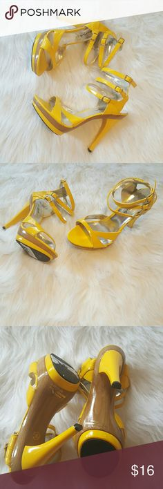 Sunshine Yellow Tripple Strap Stiletto Heel Beautiful sunshine yellow triple strap stiletto heels.  *Beautiful rich yellow *Heel height = 4 inches *Small flaw on strap, see pic #4 Very good condition Shoes Heels