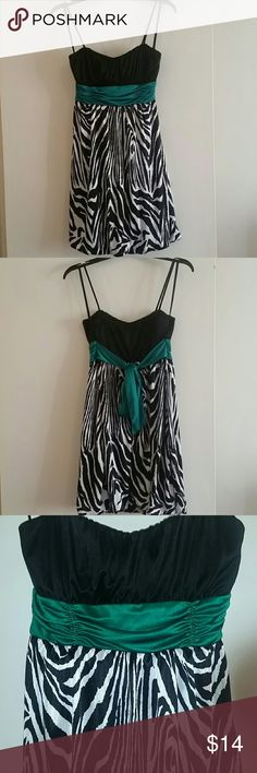 Beautiful A. Byer Dress Beautiful dress by A. Byer, size Large. It's black and white with green tie around back. 100% Polyester. A. Byer Dresses Midi
