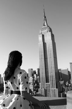 A Timeless Pursuit: Photographer Gray Malin photographed one girl in one dress – a vintage polka dot Oscar de la Renta – in cities around the world. At the Empire State Building in NYC.