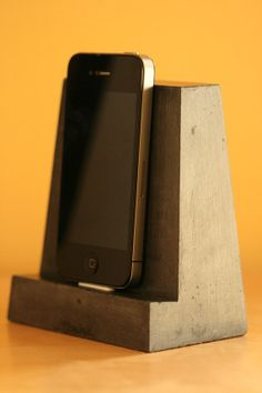 Concrete iPhone dock monolith. Cable port in the bottom for charging. $44 on Etsy. Too cool for school.