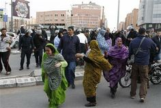 Western Saharans demonstrators run away from the police, during a protest in Laayoune, the capital of disputed territories of the Western Sahara, Tuesday, Dec. 10, 2013. (AP Photo/Paul Schemm) ▼10Dec2013AP|Western Saharans protest EU-Morocco fishing accord http://bigstory.ap.org/article/western-saharans-protest-eu-morocco-fishing-accord #Laayoune