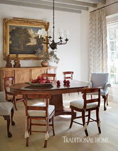 A venerable oak tree painting presides over American curly maple chairs and a pine cabinet. - Photo: Werner Straube / Design: José Solis Betancourt and Paul Sherrill  http://www.traditionalhome.com/category/beautiful-homes/and-after-elegant-desert-home?page=10