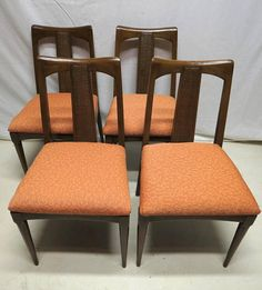 You are Buying a Set of Four (4) Vintage Teak Game Room - Card Table - Kitchen or High Back Dining Room Chairs which have the Handsomest Teak Wood Grain! The Chairs feature Classic Mid Century Design with Slightly Rounded off Corners and Straight Linear Design which has been Gently Bent for Style and Comfort! The Chairs are Super Solid and are in Excellent Condition! The Back Rests feature Woven Rattan Panels in the center. The Seat Cushions retain their Original Orange Fabric which has a…