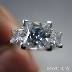 Stunning three-stone princess diamond ring. #ScottKay #engagementrings #weddingrings www.scottkay.com
