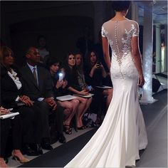 Oh my goodness, take a look at this gorgeous gown! #bridalmarket #backless