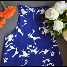 Beautiful blue printed dress It is beautiful blue printed dress with halter neck. Never worn but without tags. Chemistry Dresses