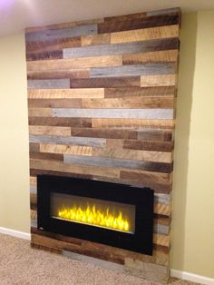 Using reclaimed wood and pallets with a modern electric fireplace More
