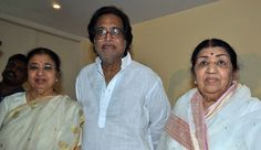 Respected legendary Bollywood playback singer Lata Mangeshkar (R), along with her brother, composer and music director pandit Hridayanath Mangeshkar (C) and her sister, singer Usha Mangeshkar pose during a press conference to announce the award function of her father's 'Deenanath Mangeshkar Puraskar Awards' at her residence, in Mumbai.