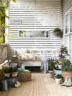 Idea for patio.  But: red cedar, on a barn door slide covering garage door.